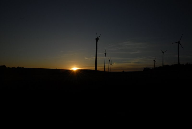sunset and wind farm in Loewenberger Land